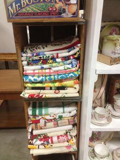 C. Dianne Zweig - Kitsch 'n Stuff: Displaying Vintage Tablecloths In Stacked Vertical Wooden Soda Boxes In Your Antique Booth Or Shop