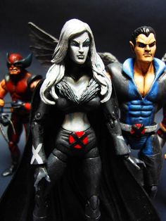 this is a marvel legends Dark X-Men Emma Frost (Diamond Form) Custom Action Figure she was made by figure realmer glennwebman69 he used a marvel legends wasp body, fodder cape, x3 jean grey head, evil lyn statue head happy pinning