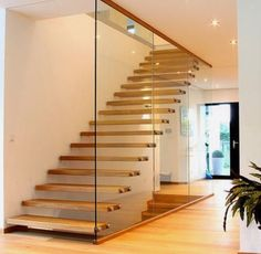 Ele & staircase of streger massif wood stairs gmbh modern solid wood multi-colored homify Wood Staircase, Floating Staircase, Staircase Design, Modern Hallway, Modern Stairs, Modern Interior, Home Interior Design, Interior Architecture, Glass Stairs
