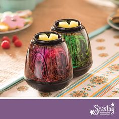 Add an artist's touch with our brand new Tiger's Eye Warmer! Each one is perfectly unique, not to mention our first hand-blown glass warmer with color-changing light! #perfection #scentsy