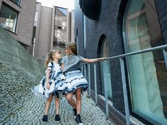 Katrina Tang Photography for Mimi Disain SS 15. Two girls wearing dresses walking on a brick street, city life, architecture #katrinatang #tangkatrina