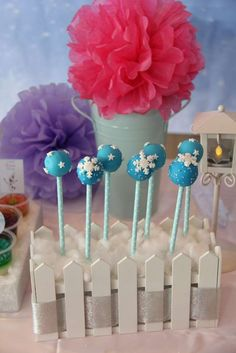 Snowflake cake pops at a Frozen birthday party! See more party planning ideas at CatchMyParty.com!