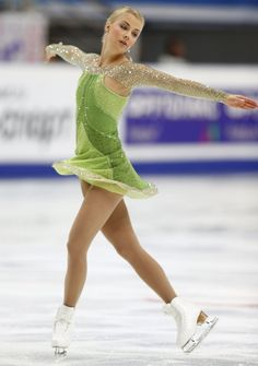 Cup of Russia - Kiira Korpi. Green dress with swarovski net sleeves