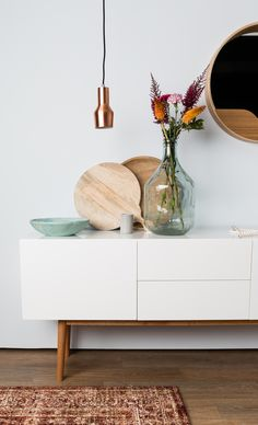 White credenza with styled vignette.