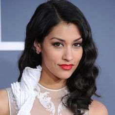 Pin for Later: Endless Gorgeous Celebrity Wedding Hair Ideas Wedding Hairstyles: All Down Get inspired to follow your inner vintage vixen with the way True Blood actress Janina Gavankar worked her Veronica Lake waves at the 2012 Grammys.
