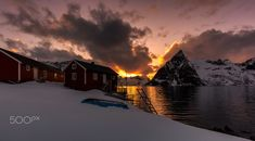 Fire in The Sky - A fiery sunset in Lofoten, Norway. This night the Reinefjord was almost calm, making for beautiful golden reflections from the sun. Lofoten, Norway, Fire, Sky, Celestial, Sunset, Night, Calm, Outdoor