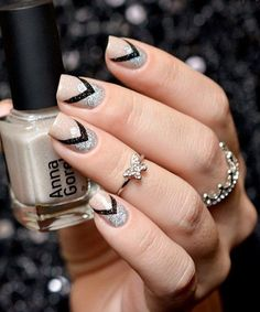 Nude, black and silver winter nail art design. A perfect combination with the use of glitter silver polish which makes the frost effect on the nails look amazing.