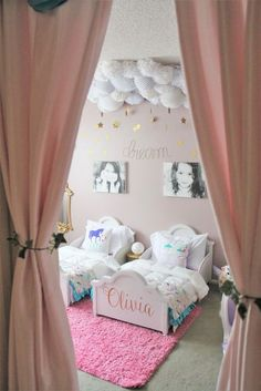 This shared big girl room for sisters is seriously dreamy. Love the cloud and stars decor!