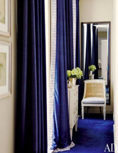 Navy curtains and blue carpeting via AD