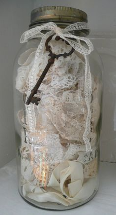 some of my vintage lace collection in a jar