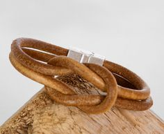 """Handcrafted tan brown """"Infinity"""" design leather bracelet with a sliding magnetic clasp. Original and trendy. The design is made with a sailor's trusty knot, the reef knot. Shipped from Mississauga, Ca"""