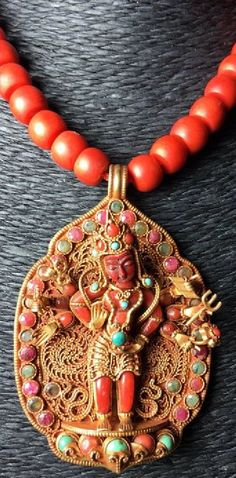 Julia Blu Collection-Gorgeous antique Indian pendant of Shiva. Gilded silver, inlaid with Coral, Turquoise, Emerald and Ruby