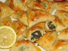 Mediterranean Spinach Pies (fatayer bi sabanekh) -Vegans particularly enjoy the combination of spinach, onions, sumac and lemon juice, encased in pastry pockets.