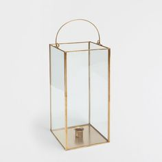 Image of the product Glass and gold metal lantern