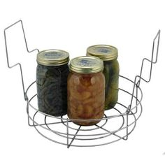 """Stainless Steel Canning Rack by Kitchen Krafts. $26.95. Small jelly jars won't fall through. Accommodates non-standard jar sizes. Stainless steel, this rack won't rust. Holds 14 jelly jars, 14 half-pint, 9 pint or 7 quart jars at one time. 12-1/4"""" in diameter and 3-3/4"""" deep (not including handles). Made in USA.. ##########################################################################################################################################################..."""