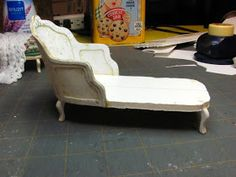 This is the project for this month. This French chaise is made from card stock, foam core and mat board. You could trim off the front ...