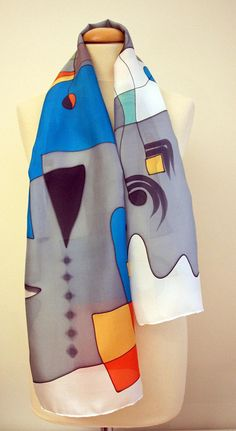 Handpainted Silk Scarf. Silk Scarf. Handpainted Silk Shawl. Add some wearable art to your outfit this season! This is a beautiful hand painted silk scarf. This unique asbtract design is in some shades of black, orange, blue, grey and other colors. This will look great on you with any