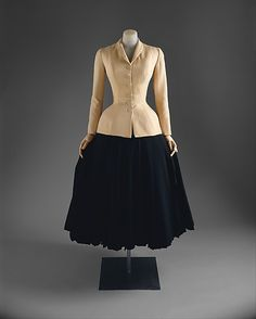 """""""Bar Suit"""" House of Dior (French, founded 1947) Designer: Christian Dior (French, Granville 1905–1957 Montecatini) Date: spring/summer 1947 Culture: French Medium: silk Dimensions: Length at CB: 17 1/2 in. (44.5 cm)"""