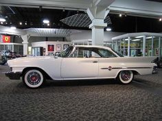 1961 Chrysler 300G - a real hot rod! It had a 413 CID V8 engine with dual 4 bbl carbs.