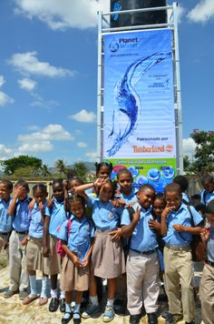 Primary schoolchildren in Santiago enjoy a newly constructed AquaTower, which will give them access to safe and clean water. Children International and Planet Water Collaborate on World Water Day Project