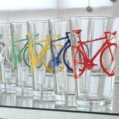 From a crafty Denver couple, this set comes with four dishwasher-safe 16oz pint glasses emblazoned with brightly multi-colored two-wheelers. #glassware #bar #home