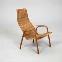 Yngve Ekström; Beech, Teak and Cane 'Kurva' Chair for Swedese, 1950.