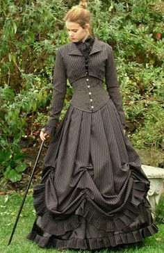 From the Steampunk Fashion Guide to Skirts & Dresses: Bell Skirts - Woman in black pinstriped gothic victorian bell dress