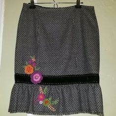 Houndstooth Pencil Skirt A fabulous piece for the winter season. Classic houndstooth pattern with chartreuse green detailing, velvet trim and crocheted/embroidered flowers. Wore it a few times years ago, and has been sitting in my closet ever since. It's time for someone else to rock this fabulous skirt! Nanette Lepore Skirts Pencil