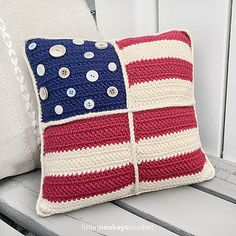 """Celebrate your independence with this patriotic Americana-style throw pillow pattern! Assorted buttons from your stash give the pillow a unique finished look. Pattern fits a standard 12"""" pillow insert (which can be found at most large craft stores)."""