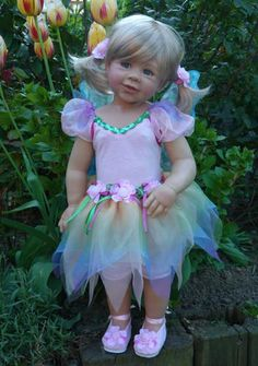 I am a  cllector of Dolls in both pictures and Dolls.. this one happens to look a lot like my oldest grandaughter who is 17 years old now it made me cry when I seen it on Pintrest one day thank you...