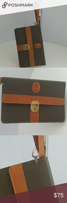 VINTAGE CHARLES JOURDAN LOCKING CLUTCH W/ KEY! Crazy that this clutch is in such good condition wrist strap is good locking mechanism still works and the key is with the bag! 7.5 x 11 rough measure. see pics for condition! VINTAGE HANDBAG COLLECTOR'S DREAM!  Make offers. I 📬SHIP FAST! Charles Jourdan Bags Clutches & Wristlets