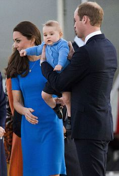 Come to daddy...Prince William carried baby George after Kate held him while walking off their plane as they land in Australia's capital Canberra, April 20, 2014