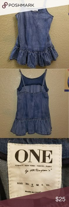 NWOT One teaspoon denim tank NWOT One Teaspoon denim tank. Has adjustable straps with brass hardware and a flared ruffle hem.  This is a wardrobe must have! Grab it before summer! Has size chart as posted in pic.  size is Small. One Teaspoon Tops Tank Tops