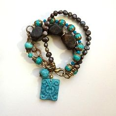 $24.00.  Obsidian Magnesite and Freshwater Pearls from my favorite vendor.  There's only one.