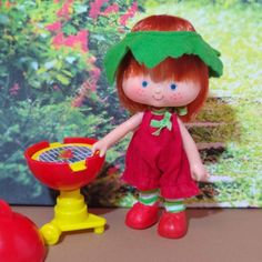 Gorgeous Strawberry Shortcake second edition of curved hands, she enjoys a beautiful hot day at a garden party grilling delicious strawberries, she wears the vintage outfit Berry Patch Sun Suit Set from Kenner's Berry Wear series. Includes a complete strawberry grill from the Berry Garden House Set (Kiosk) Hot Days, Kiosk, Strawberry Shortcake, Strawberries, Grilling, Vintage Outfits, Patches, Suit, Hands