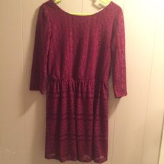 Maroon Dress with Elastic Waist Maroon dress with three quarter length sleeves. Back scoops down slightly. Has loops for a thin belt. Worn once. Size large. Dresses