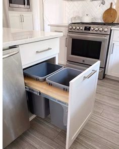 10 New Kitchen Organization & Cabinet Storage Ideas Fun ideas for a more organized kitchen! Kitchen cabinets storage tips and beautiful home decor inspiration from a new farmhouse style white kitchen. Love the double trash can cabinet! Kitchen Room Design, Modern Kitchen Design, Home Decor Kitchen, Kitchen Interior, Home Kitchens, Interior Modern, Kitchen Cabinet Design, Small Kitchen Decorating Ideas, Home Decorating
