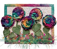 Aren't these the happiest flowers you've ever seen in a quilt? From the book More Fabulous Flowers: Mini Quilts in Dimensional Applique.