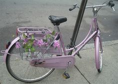 """spotted this unseasonably floral bicycle in scenic Somerville. It is a Batavus Old Dutch, in """"head-to-toe"""" lilac. The pannier-basket is decorated with garlands of faux wisteria."""