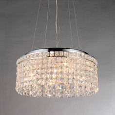 Covered by rows of shiny crystals, the four lights on this Melinda pendant create a cozy, intimate environment. This pendant features a sturdy metal frame for durability and a stylish chrome finish that suits a wide range of decors.