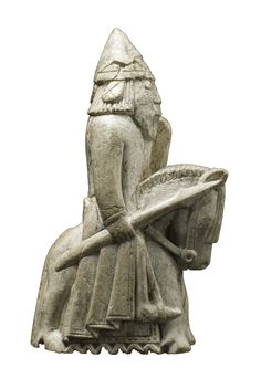 Lewis Chessmen Knight: wears a protective coat, divided at the front and back for ease of movement. He carries a kite shaped shield and a lance ready for battle and sits on a horse which which looks like the size of a Shetland pony!