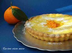 La crostata alla crema di yogurt e arancia: un guscio di croccante pasta frolla accoglie una delicata e profumatissima crema di yogurt e arancia!