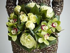 In this Green Gage bouquet areVanilla Sky roses, cymbidium orchids and brassicas, together with aspidistra leaves.