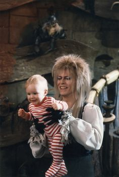 """jimhenson-themuppetmaster: """"A cool photo of Toby Froud and David Bowie on the set of Labyrinth. David Bowie Labyrinth, Labyrinth 1986, Labyrinth Movie, Sarah Labyrinth, David Bowie Goblin King, Labyrinth Tattoo, Jennifer Connelly, Charlie Chaplin, Glam Rock"""