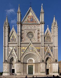 Orvieto Cathedral, Italy. 1290 - 1591. Gorgeous building... and such a facade!!! It is lavishly ornamented with golden mosaics.