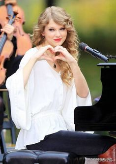 Honestly, I <3 Taylor Swift's music a whole honey bunches of oats, and have, since, like ever. She's a cool cat :)