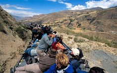 """The world's scariest train rides: Nariz del Diablo, Ecuador - The """"Devil's Nose"""" train travels between Alausi, close to the Andean city of Riobamba, and Palmira, around 50 miles to the south. The train chugs along at a very leisurely pace, giving passengers plenty of time to enjoy the sight of Ecuador's """"Avenue of the Volcanoes""""."""