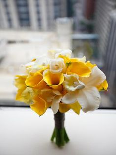 Natural Beauties, Bridal bouquet of yellow calla lilies, white cymbidium orchids, white cattleya orchids