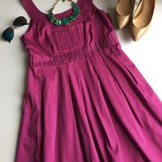 Fuscia/plum color dress Cotton/ spandex  blend. Worn once or twice. Polyester lining. 37 inches long. 30 inch waist. 34 inch bust Dresses