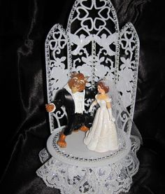 click here for your unique wedding cake topper http://uniqueweddingcreations.ca/product/beauty-and-the-beast-wedding-cake-topper/